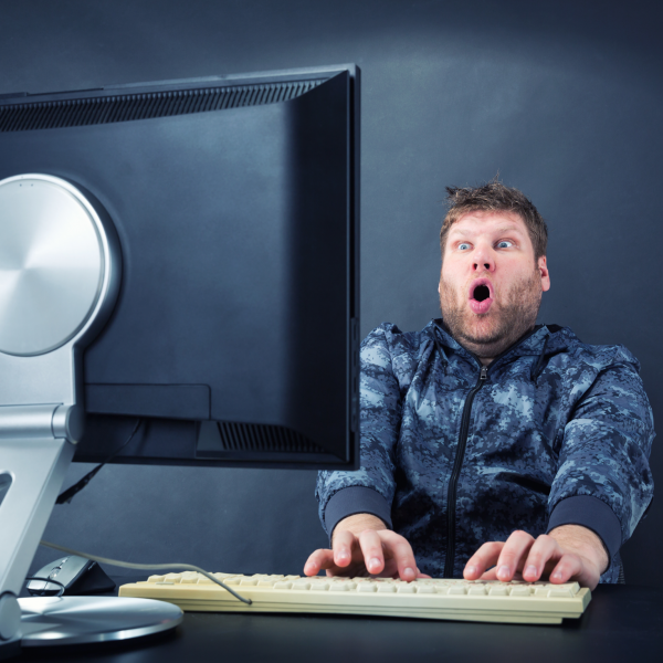 student very surprised at the contents on his computer monitor